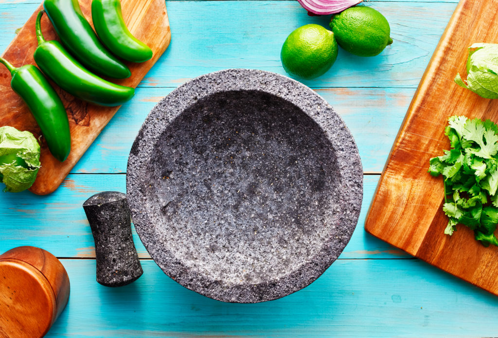 Mexican molcajete utensil made or volcanic rock